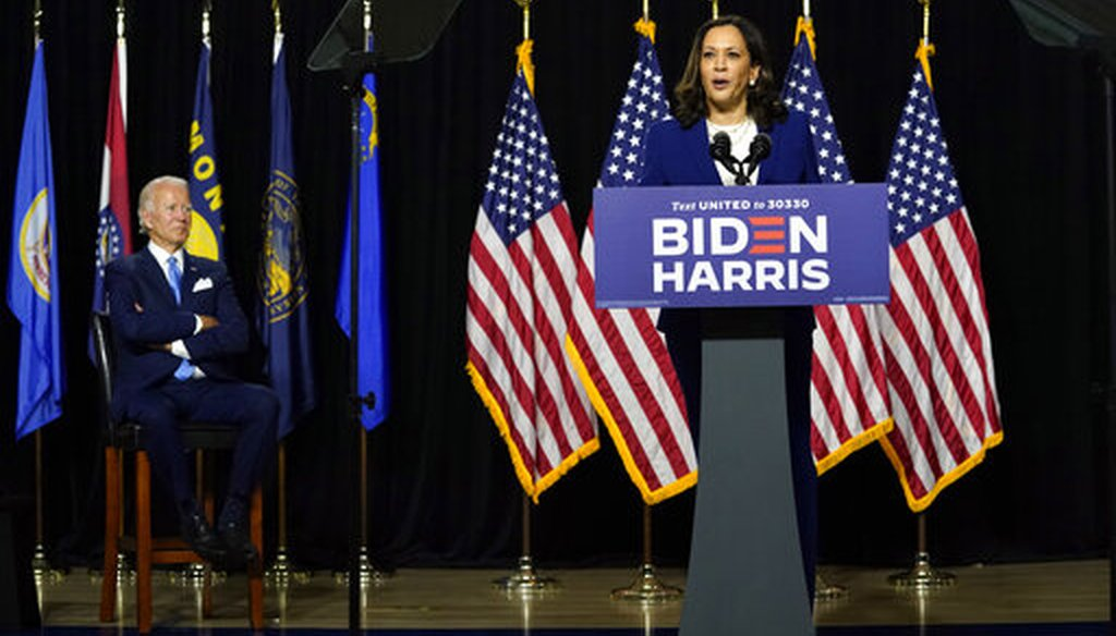 Democratic presidential candidate and former Vice President Joe Biden listens as his running mate, Sen. Kamala Harris, D-Calif., speaks during a campaign event at Alexis Dupont High School in Wilmington, Del., on Aug. 12, 2020. (AP/Kaster)