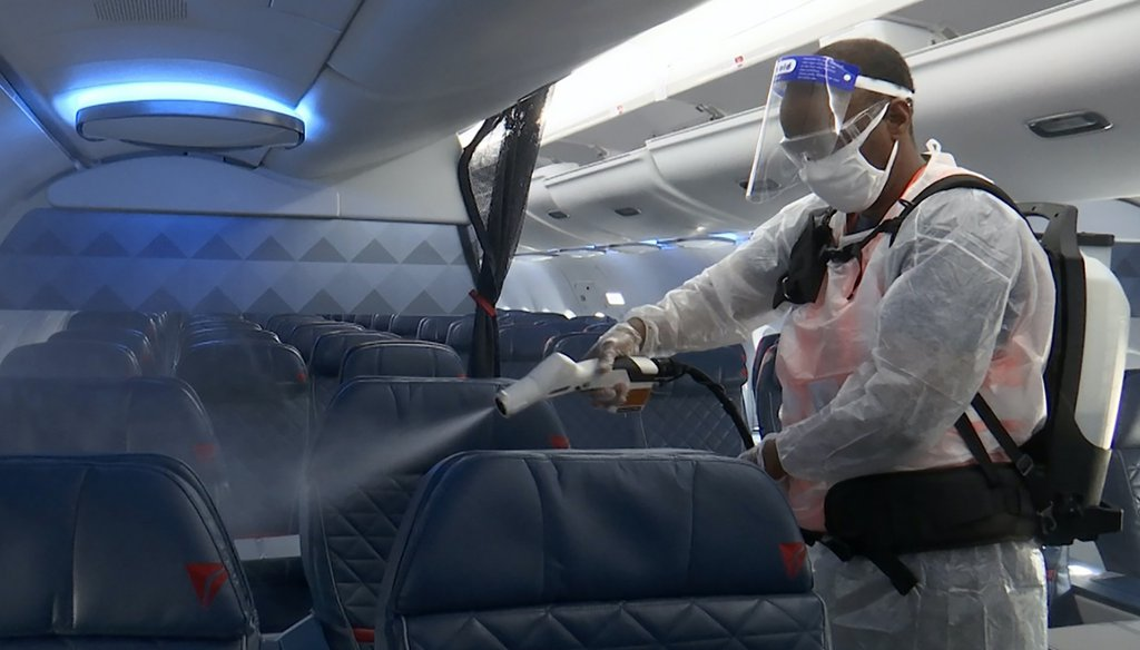 An employee disinfects the inside of a Delta Airplane. (AP)