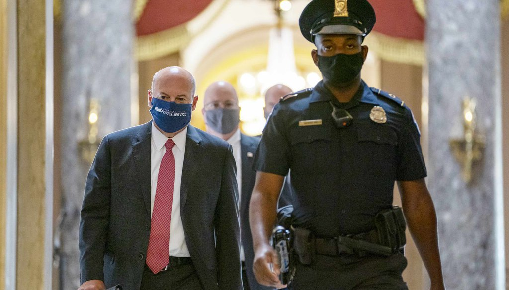 In this Aug. 5, 2020, file photo Postmaster General Louis DeJoy, left, is escorted to House Speaker Nancy Pelosi's office on Capitol Hill in Washington. (AP)