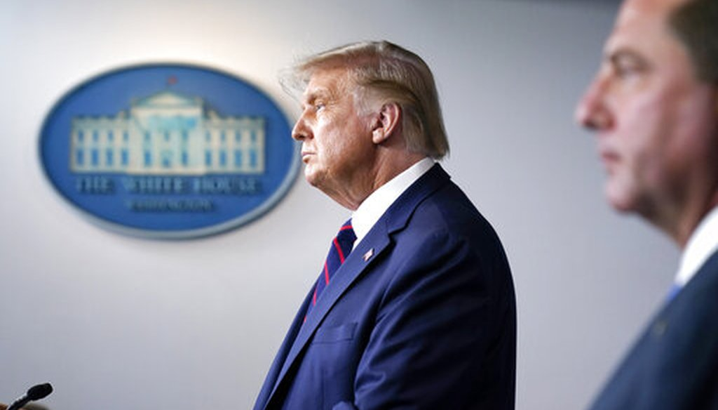 President Donald Trump speaks as Health and Human Services Secretary Alex Azar listens during a media briefing in the James Brady Briefing Room of the White House, Aug. 23, 2020. (AP)