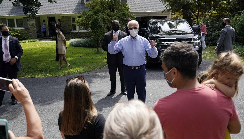 Democratic presidential candidate Joe Biden talks to neighbors gathered outside after he attended an event with local union members in the backyard of a home in Lancaster, Pa., on Sept. 7, 2020. (AP)