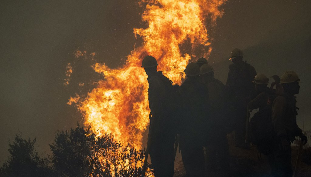 Firefighters monitor a controlled burn near Big Sur, Calif. (AP)