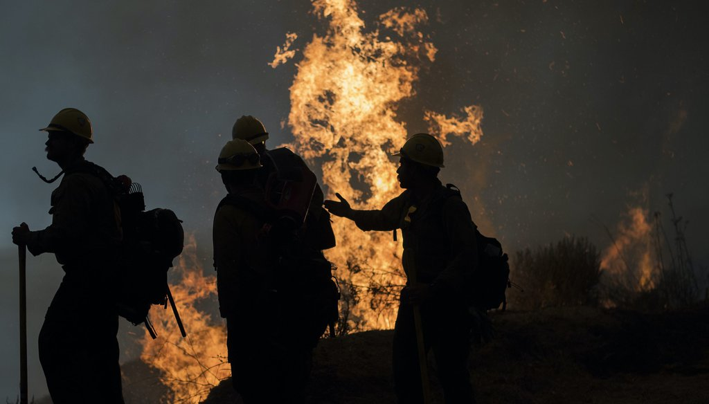 Firefighters monitor a controlled burn along Nacimiento-Fergusson Road to help contain the Dolan Fire near Big Sur, Calif., on Sept. 11, 2020. (AP)