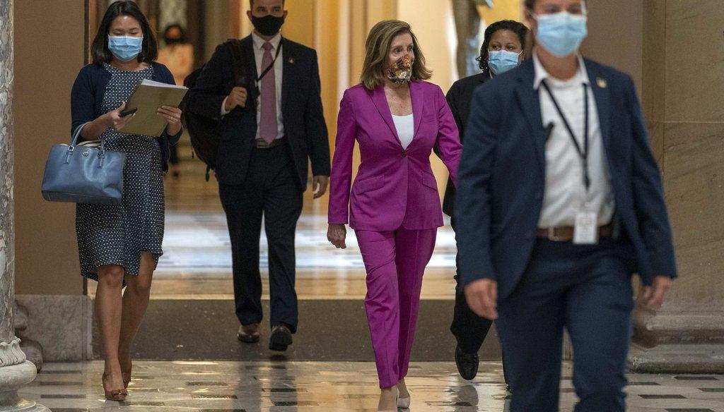 House Speaker Nancy Pelosi of Calif., center, walks to her office on Sept. 14, 2020, on Capitol Hill in Washington. (AP)