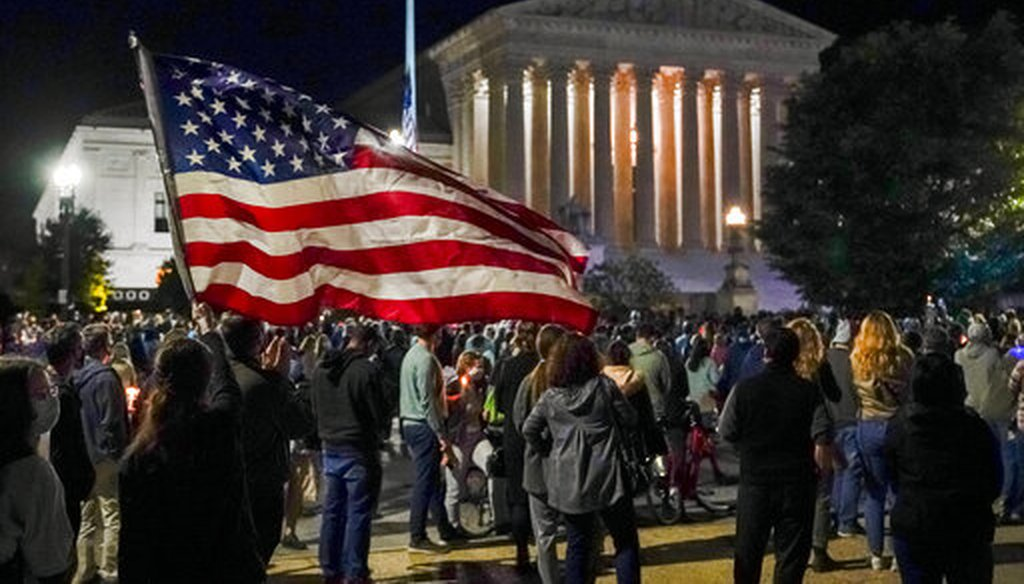 People gather at the Supreme Court on Sept. 19, 2020, to honor the late Justice Ruth Bader Ginsburg. (AP)