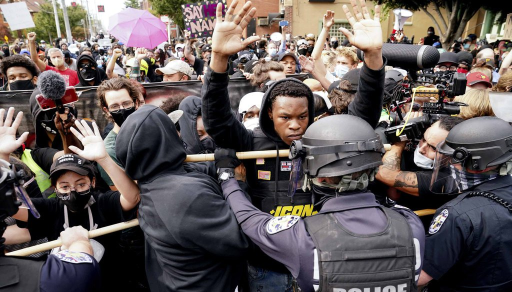 Police and protesters converge during a demonstration on Sept. 23, 2020, in Louisville, Ky. (AP)