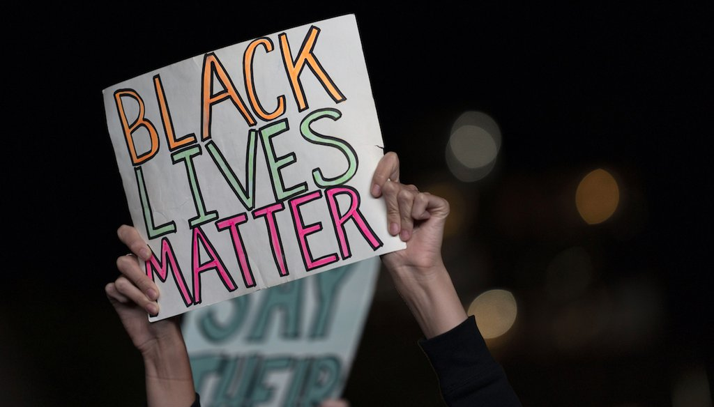 A protester holds up a Black Lives Matter sign as she and others gather in the Brooklyn borough of New York, late Wednesday, Sept. 23, 2020, in New York, following a Kentucky grand jury's decision on the killing of Breonna Taylor. (AP)