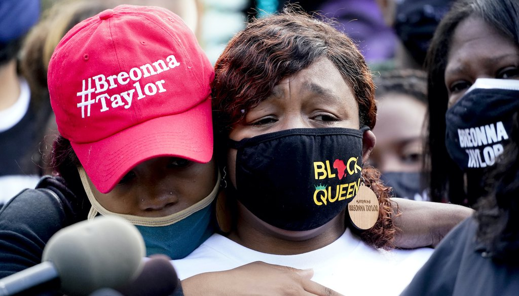 Tamika Palmer, the mother of Breonna Taylor, right, listens to a news conference, Friday, Sept. 25, 2020, in Louisville, Ky. (AP)