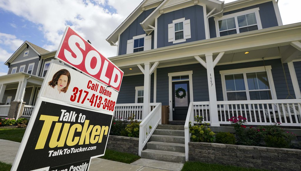 "A ""sold"" sign is posted on a home in Westfield, Ind., on Sept. 25, 2020. (AP)"