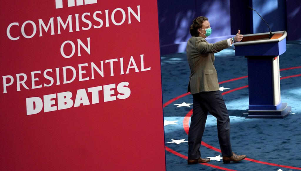A person gestures while taking the stage during a rehearsal ahead of the first presidential debate. (AP)
