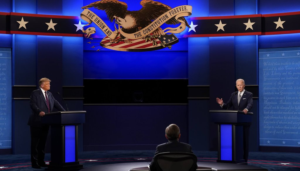 President Donald Trump, left, and Democratic presidential candidate former Vice President Joe Biden, right, with moderator Chris Wallace, center, of Fox News during the first presidential debate on Sept. 29, 2020. (AP)