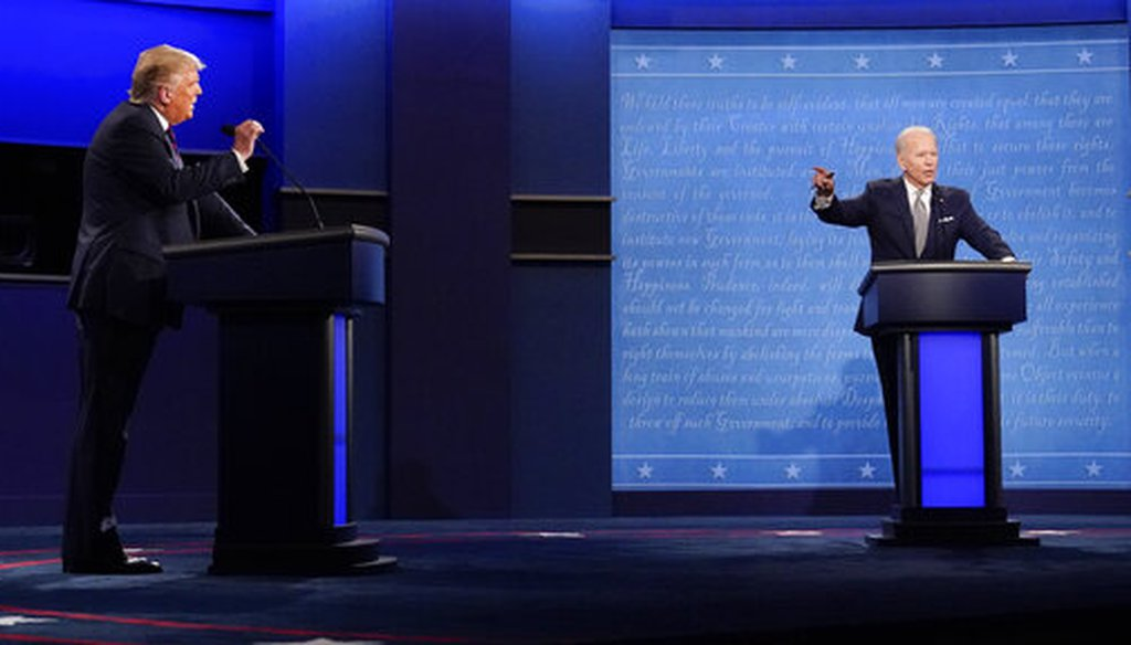 President Donald Trump, left, and Democratic presidential candidate and former Vice President Joe Biden, right, gesture during the first presidential debate on Sept. 29, 2020, at Case Western University and Cleveland Clinic, in Cleveland, Ohio. (AP/Cortez