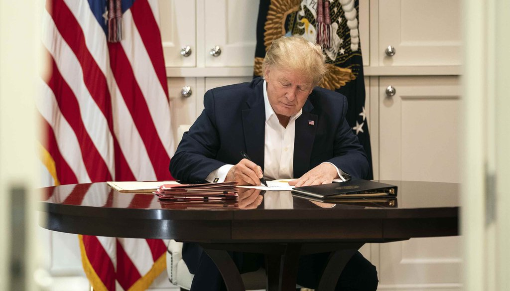 In this image released by the White House, President Donald Trump works in the Presidential Suite at Walter Reed National Military Medical Center in Bethesda, Md., on Oct. 3, 2020, after testing positive for COVID-19. (AP)