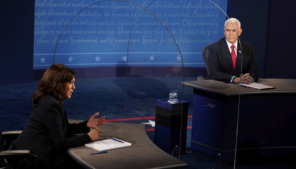 Vice President Mike Pence looks at Democratic vice presidential candidate Sen. Kamala Harris, D-Calif., as she answers a question during the vice presidential debate Oct. 7, 2020, at Kingsbury Hall on the campus of the University of Utah. (AP)