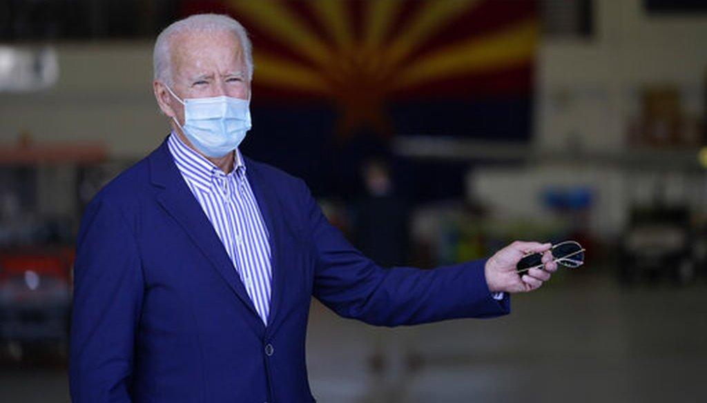 Democratic presidential candidate Joe Biden takes questions at a hangar in Phoenix, Oct. 8, 2020. (AP)