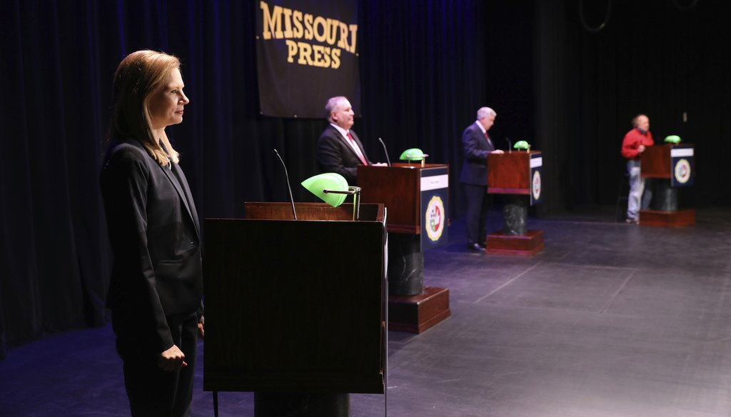 Missouri gubernatorial candidates, from left, State Auditor Nicole Galloway, Libertarian candidate Rik Combs, Gov. Mike Parson, and Green Party candidate Jerome Bauer, take the stage for the Missouri gubernatorial debate on Oct. 9. (AP)