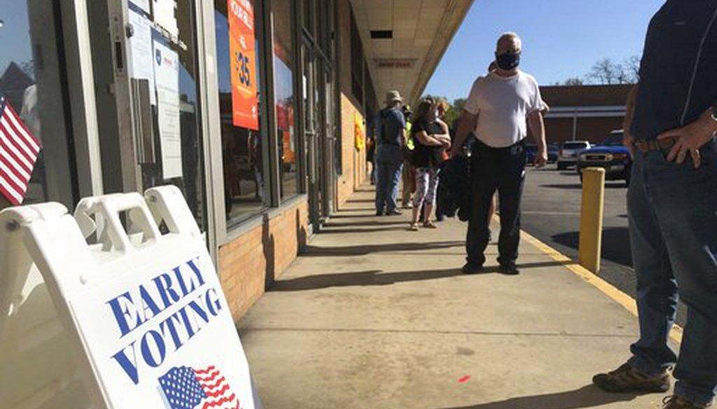 Voters wait in line on Oct. 21, 2020, in Cross Lanes, W.Va. (AP)