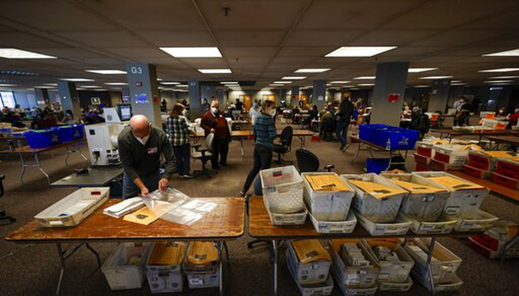 Workers count Milwaukee County ballots on Election Day at Central Count, Nov. 3, 2020, in Milwaukee. (AP)