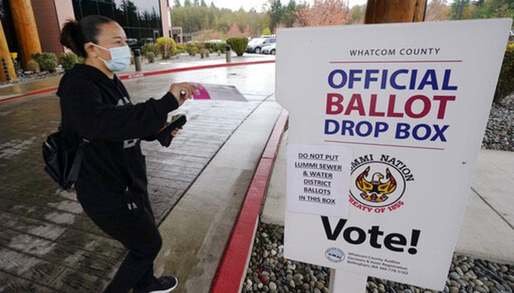 Lummi Tribal member Patsy Wilson casts her ballot into a ballot drop box on Nov. 3, 2020, near Bellingham, Wash. (AP)