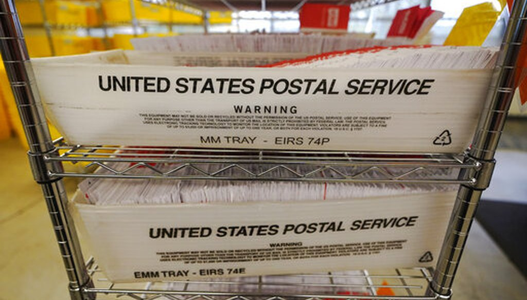 Mailed ballots fill U.S. Postal Service trays at the King County Elections office on Nov. 3, 2020, in Renton, Wash. (AP/Warren)