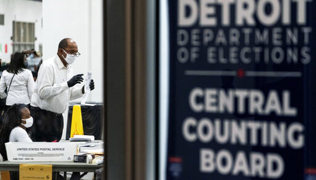 Election inspectors count ballots into the early morning hours of Wednesday, Nov. 4, 2020, at the central counting board in Detroit. (AP)