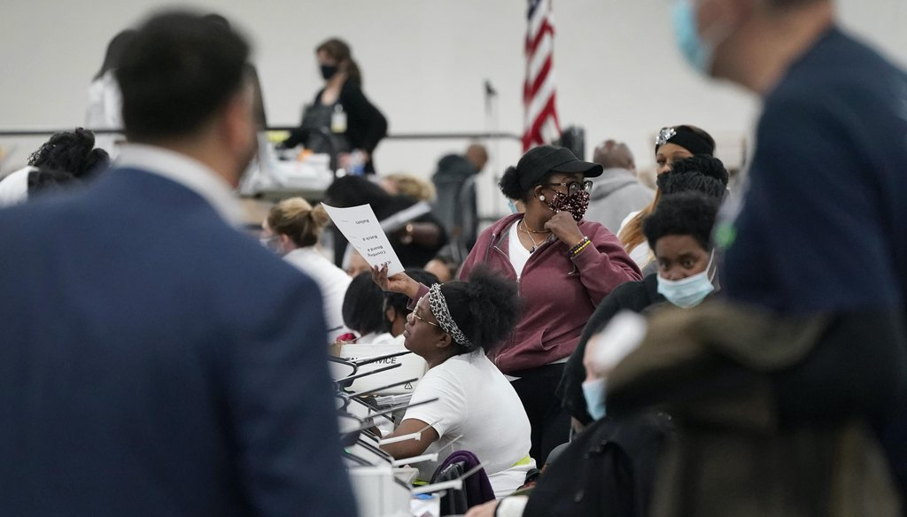 Election challengers observe as ballots are counted at the central counting board on Nov. 4, 2020, in Detroit. (AP)