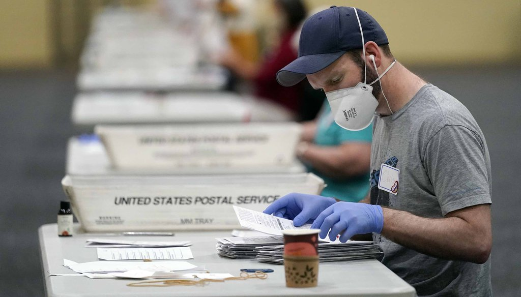 Workers prepare mail-in ballots for counting on Nov. 4, 2020, at the convention center in Lancaster, Pa., following Tuesday's election. (AP)