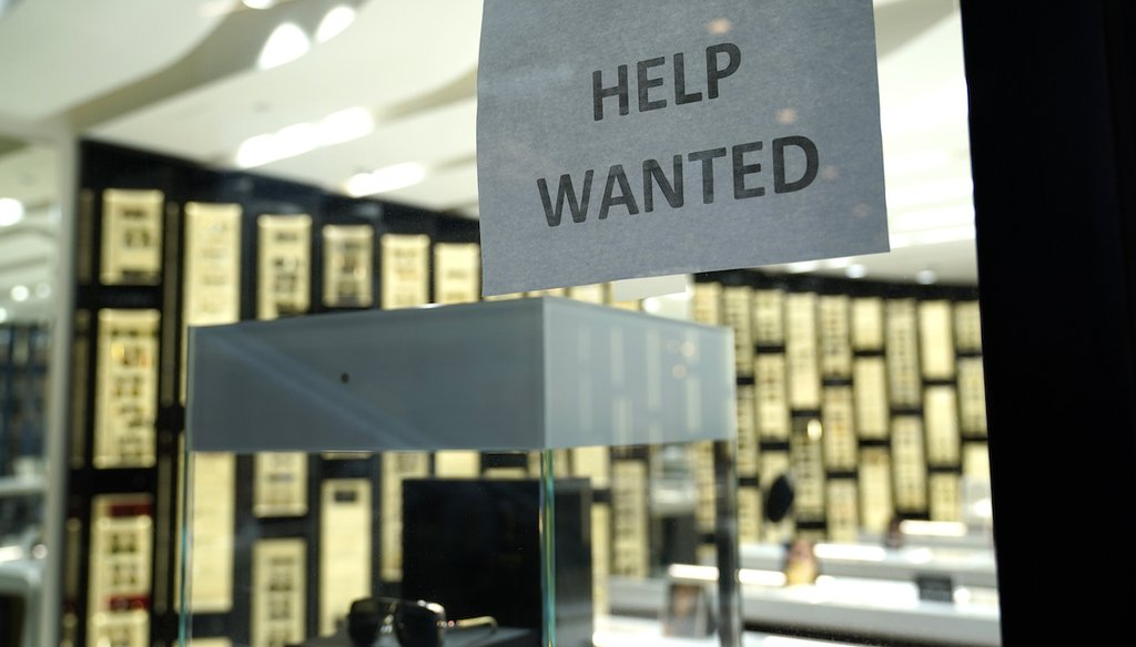 A Help Wanted sign is posted at a store at Brickell City Centre on Nov. 6, 2020, in Miami. (AP/Sladky)