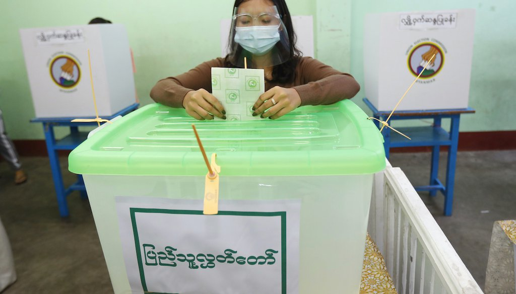 A voter casts a ballot Nov. 8, 2020, at a polling station in Naypyitaw, Myanmar. (AP)