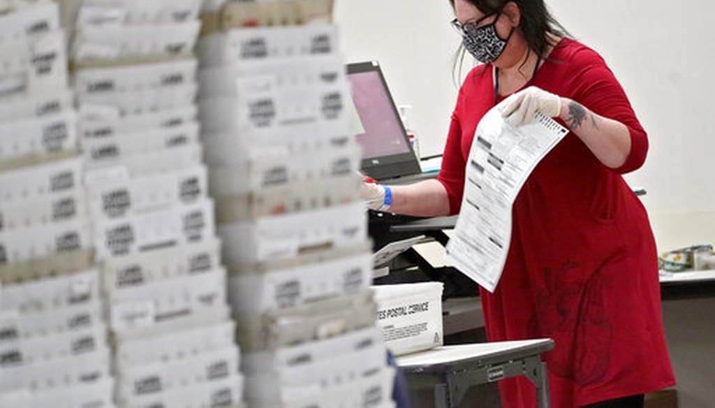 Arizona election officials count ballots inside the Maricopa County Recorder's Office in Phoenix on Nov. 6, 2020. (AP)