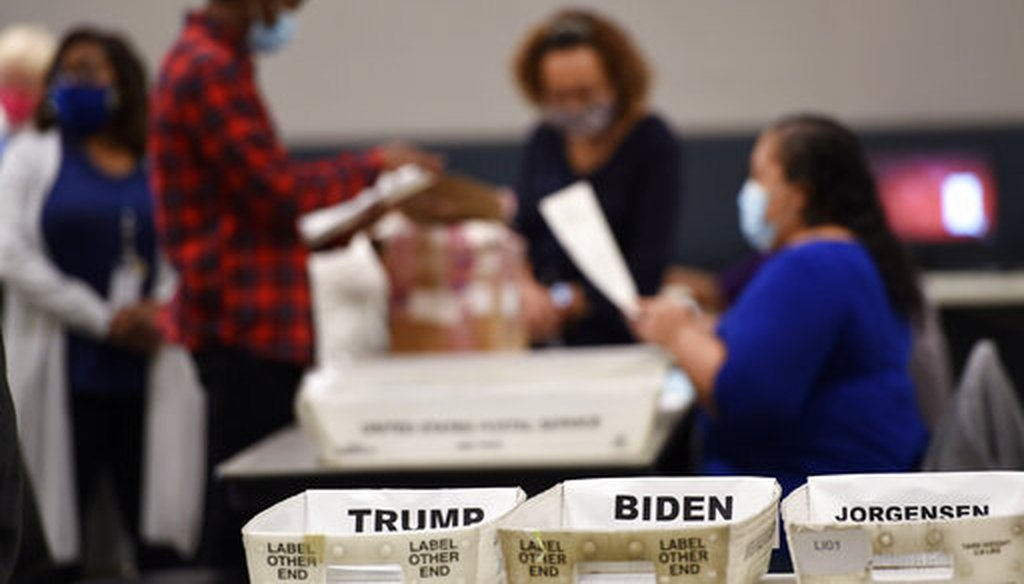 Cobb County election officials sort ballots during an audit, Nov. 13, 2020, in Marietta, Ga. (AP)