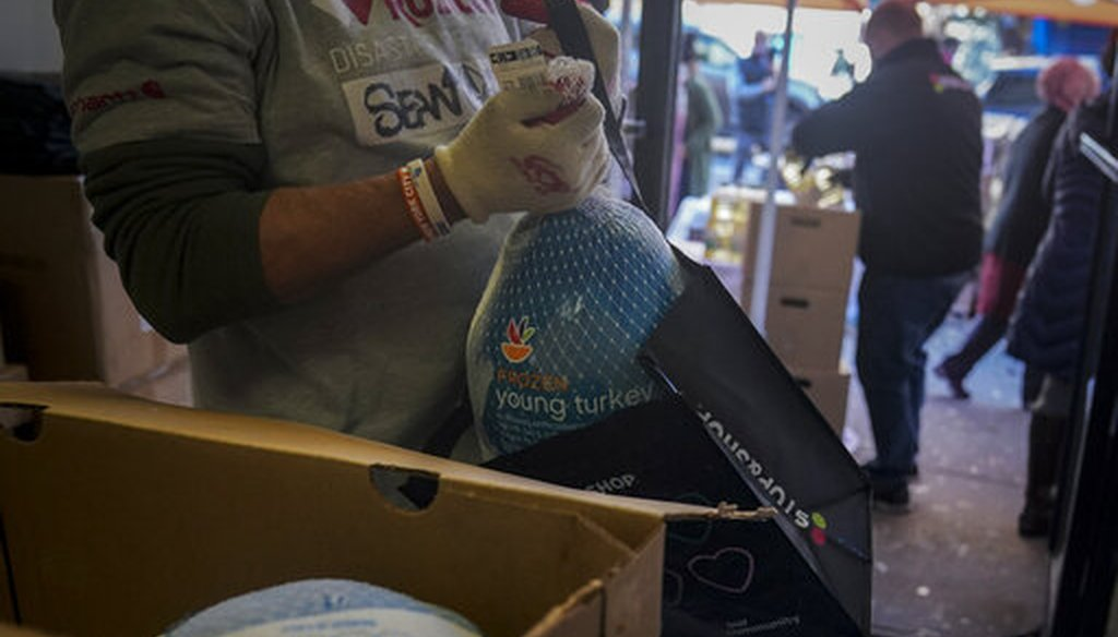 A volunteer bag turkeys at Harlem's Food Bank For New York City, a community kitchen and food pantry, on Nov. 16, 2020, in New York. (AP/Matthews)