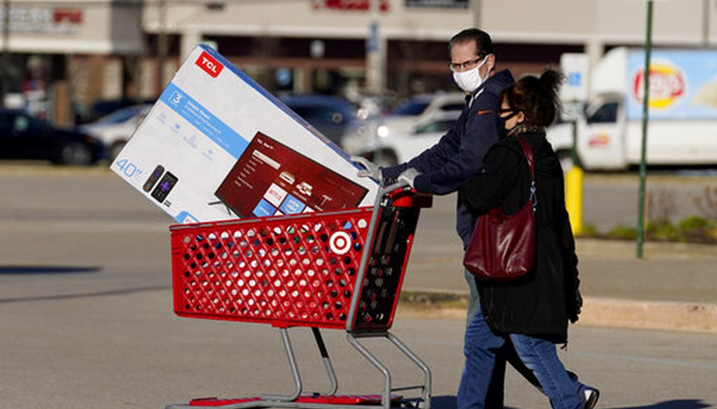 Shoppers leave a Target store after shopping in Niles, Ill., on Nov. 28, 2020. (AP)