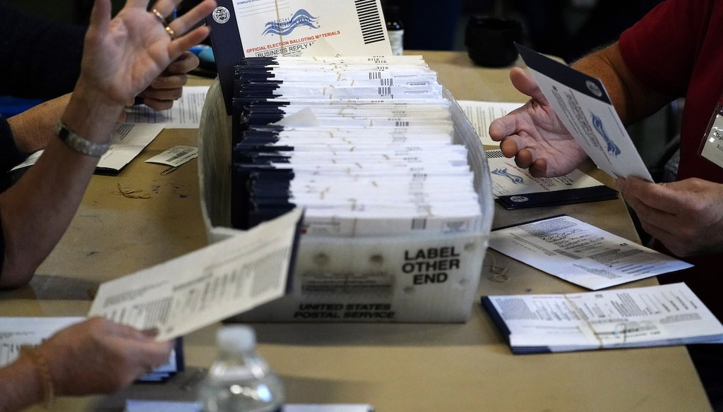 Chester County election workers process mail-in and absentee ballots for the 2020 general election at West Chester University in West Chester, Pa., on Nov. 4, 2020. (AP)
