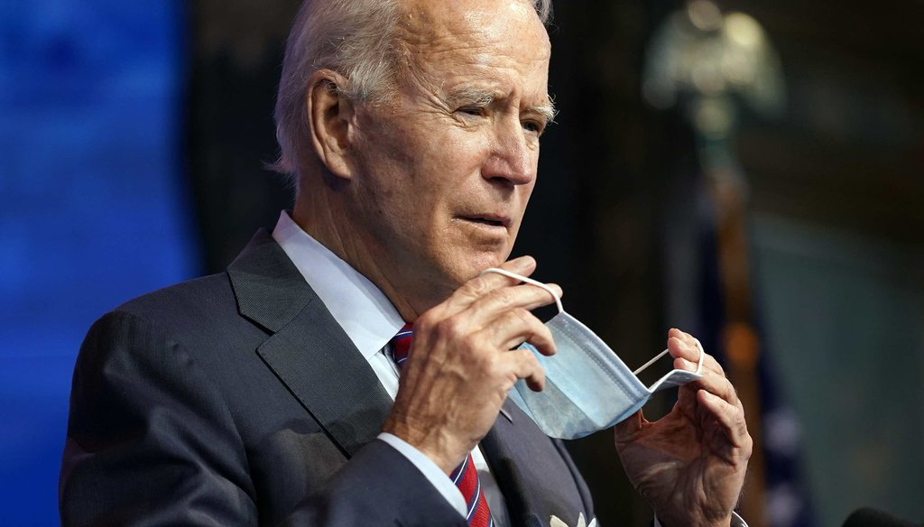 President-elect Joe Biden puts on his face mask after speaking about jobs at The Queen theater on Dec. 4, 2020, in Wilmington, Del. (AP)