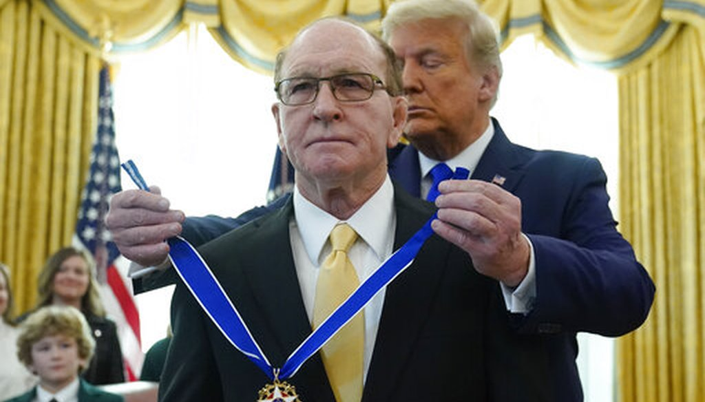 President Donald Trump awards the Presidential Medal of Freedom, the highest civilian honor, to Olympic gold medalist and former University of Iowa wrestling coach Dan Gable on Dec. 7, 2020. (AP)