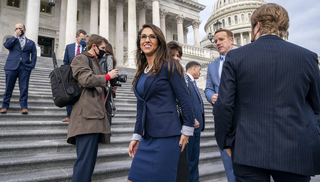 Rep. Lauren Boebert, R-Colo., center, smiles after joining other freshman Republican House members for a group photo at the Capitol in Washington, Jan. 4, 2021. (AP)