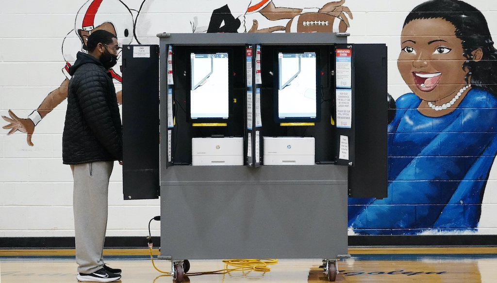 A voter casts a ballot during Georgia's runoff election on Jan. 5, 2021, in Atlanta. (AP)