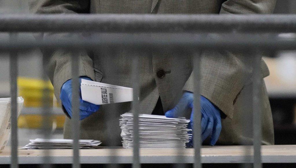 An official counts ballots for Georgia's Senate runoff election at the Georgia World Congress Center on Jan. 6, 2021, in Atlanta. (AP)