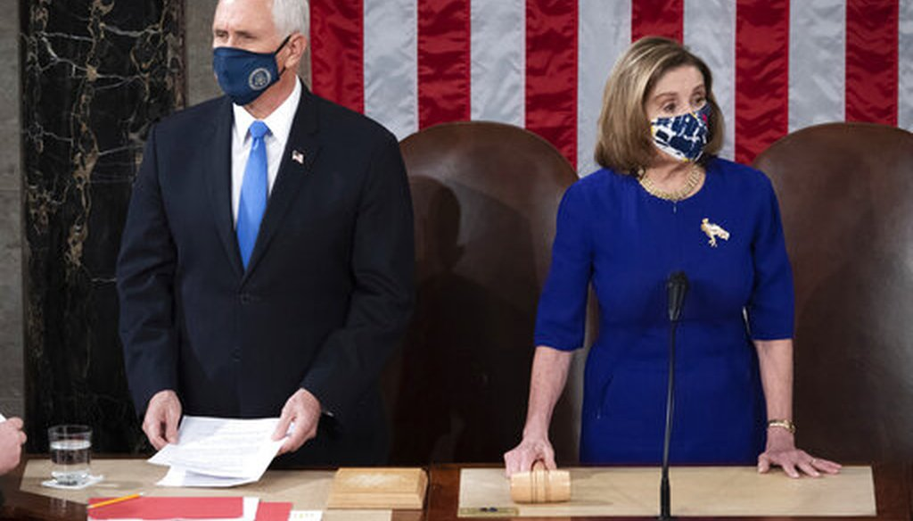 Vice President Mike Pence presides over a joint session of Congress on Jan. 6, 2021. Speaker of the House Nancy Pelosi, D-Calif., is at right. (Pool via AP)