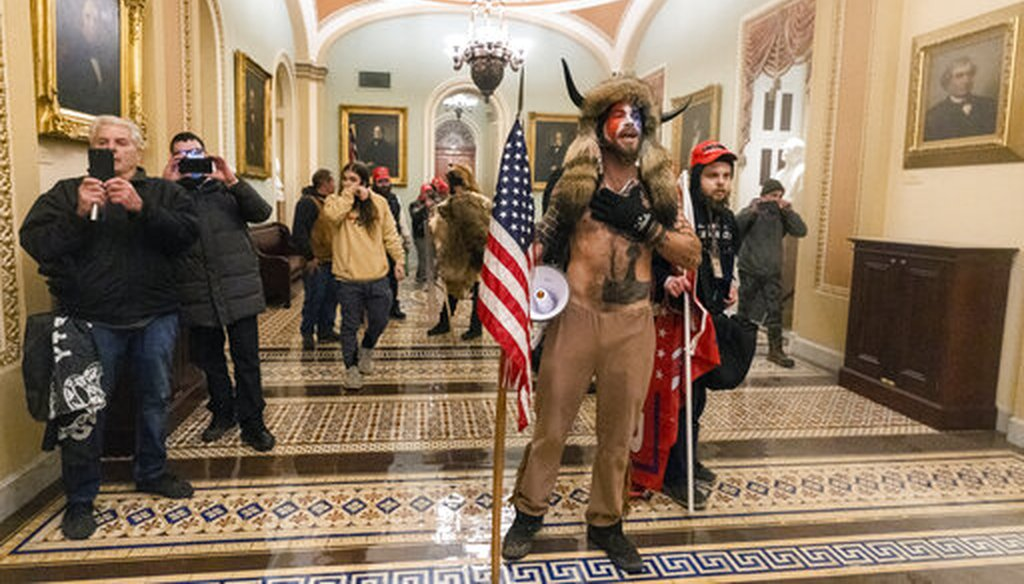 Supporters of President Donald Trump stormed the U.S. Capitol and were photographed outside the Senate Chamber on Jan. 6, 2021 in Washington. (AP/Balce Ceneta)