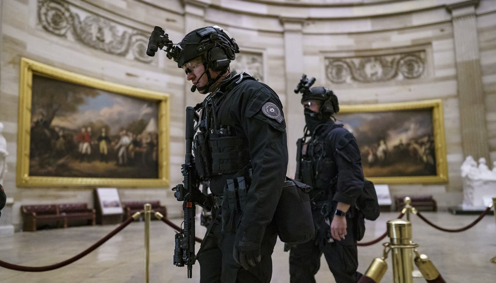 Members of the U.S. Secret Service Counter Assault Team walk through the Rotunda as they and other federal police forces responded as violent protesters loyal to President Donald Trump stormed the U.S. Capitol. (AP Images)