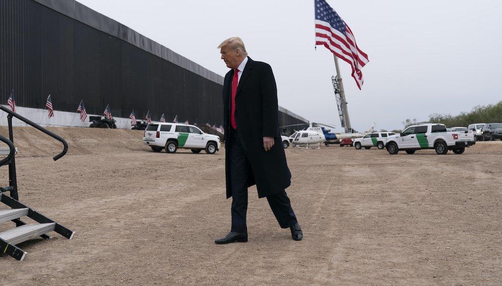 President Donald Trump near a section of the U.S.-Mexico border construction, Jan. 12, 2021, in Alamo, Texas. (AP)
