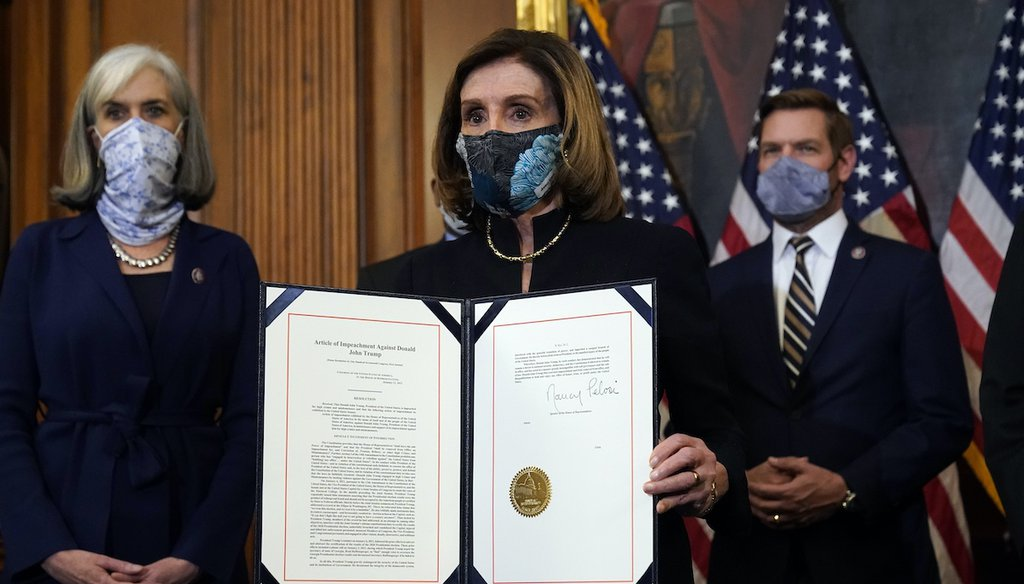 House Speaker Nancy Pelosi of Calif., displays the signed article of impeachment against President Donald Trump before transmission to the Senate on Jan. 13, 2021. (AP)