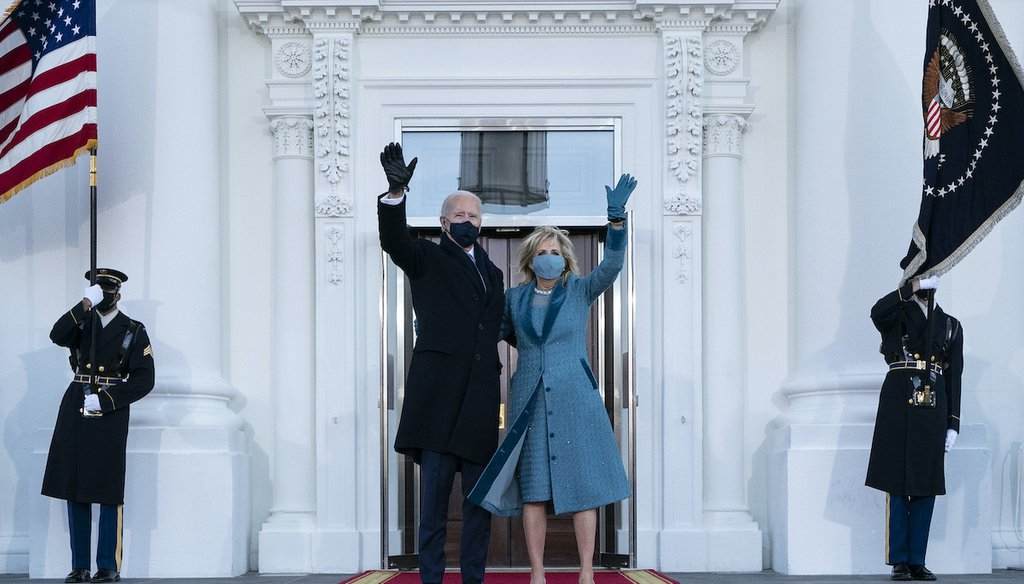 President Joe Biden and first lady Jill Biden wave as they arrive at the North Portico of the White House, Jan. 20, 2021. (AP)