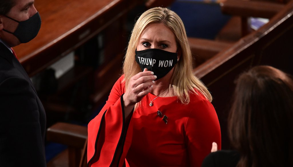 """In this Jan. 3, 2021, file photo, Rep. Marjorie Taylor Greene, R-Ga., wears a """"Trump Won"""" face mask as she arrives on the floor of the House to take her oath of office on opening day of the 117th Congress at the U.S. Capitol in Washington. (AP)"""