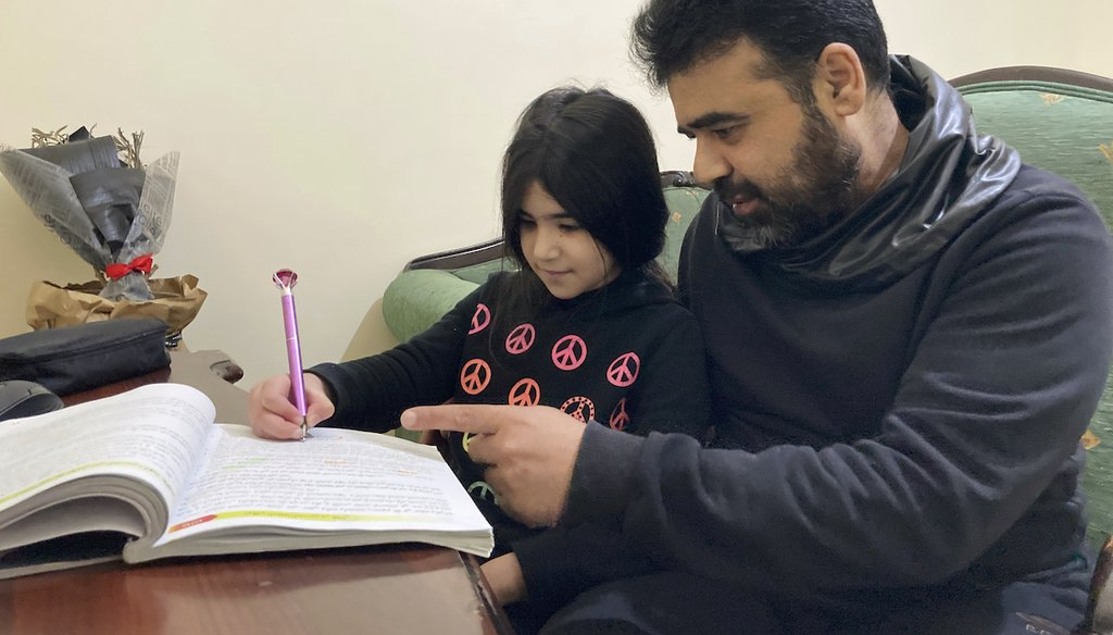Syrian refugee Mahmoud Mansour, 47, with daughter Sahar, 8, at an apartment in Amman, Jordan, Jan. 20, 2021. Mansour's family had completed paperwork to go to the U.S. before the Trump administration halted the refugee program in 2017. (AP)