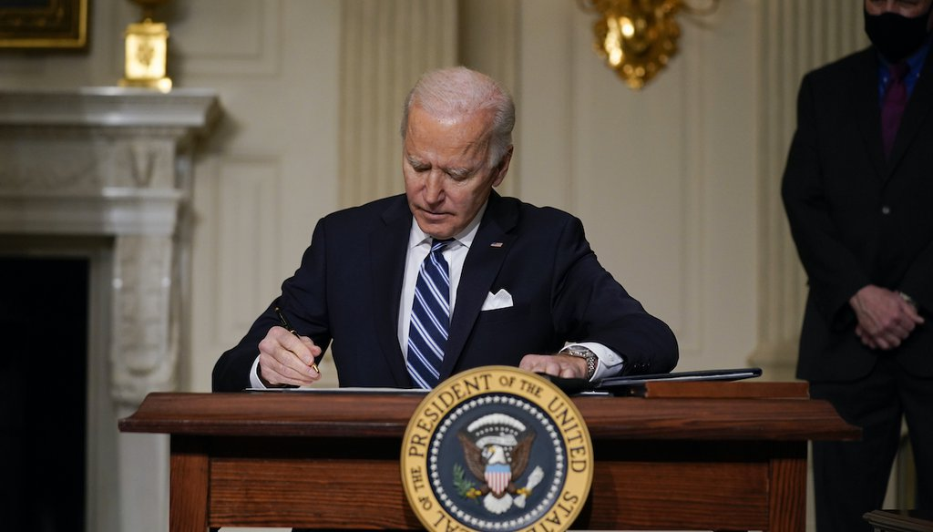 President Joe Biden signs an executive order on climate change, in the State Dining Room of the White House on Jan. 27, 2021, in Washington. (AP)