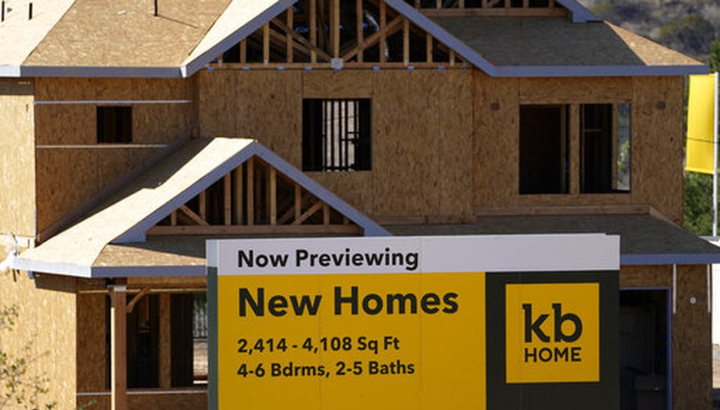 There's strong demand for homes, but high lumber prices are limiting builders' ability to capitalize, analysts say. (AP)