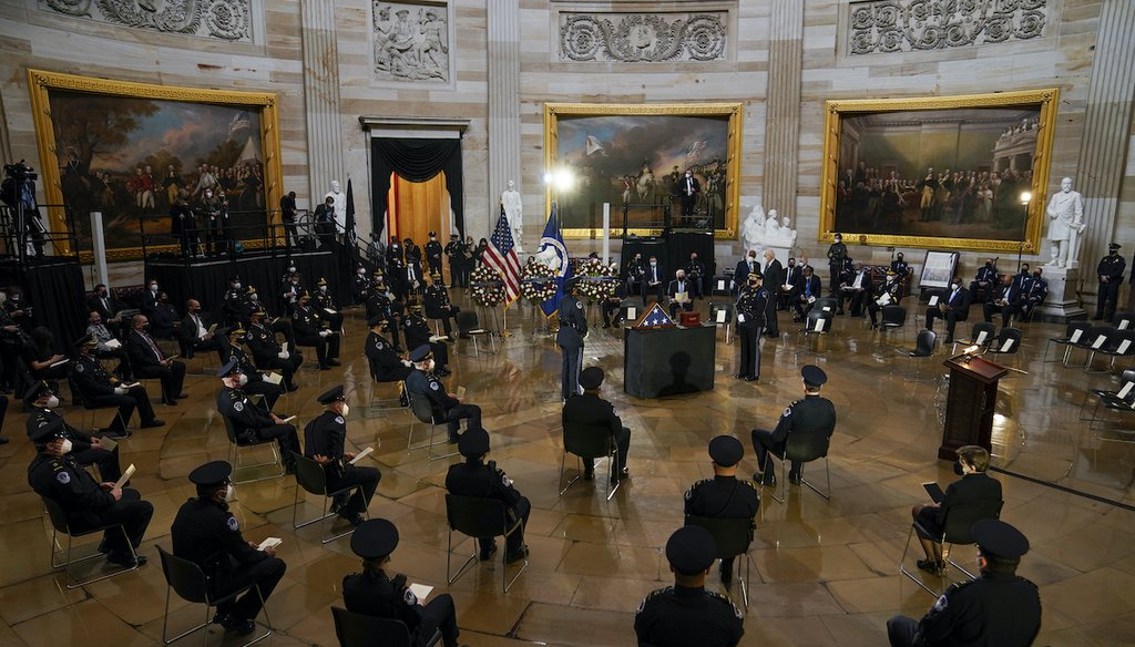 U.S. Capitol Police officers and other guests sit during a ceremony memorializing U.S. Capitol Police officer Brian Sicknick, as an urn with his cremated remains lies in honor on a table in the Capitol Rotunda on Feb. 3, 2021, in Washington. (AP/Freeman)